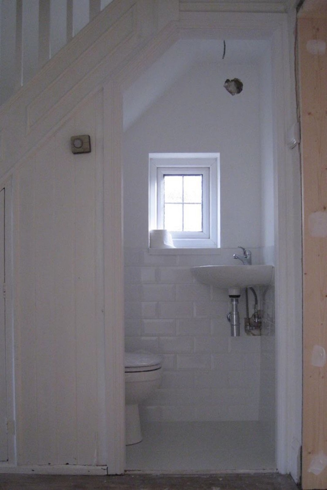 Powder room under the stairs content in a cottage for Powder room door size