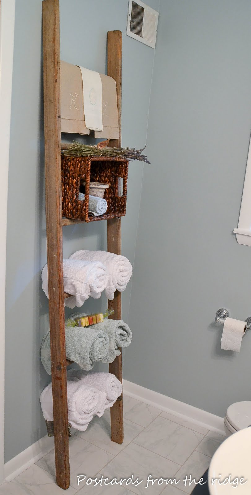 old ladder used for towel storage in bathroom