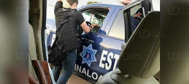 """Supuestos """"sicarios"""" armados y empecherados son exhibidos platicando con estatales en Sinaloa"""