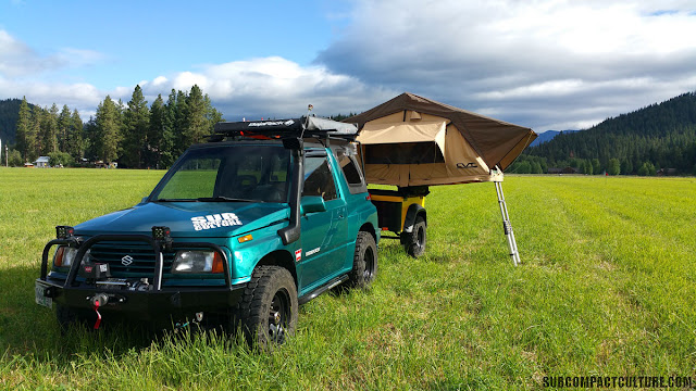 Teal Terror, Dinoot trailer, CVT RTT: Our beloved Suzuki Sidekick, the Teal Terror along with our Dinoot trailer and CVT rooftop tent set-up.