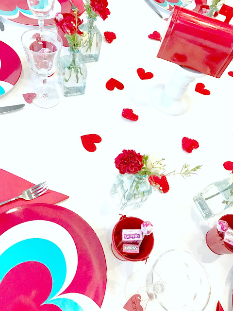Felt hearts scattered over table.