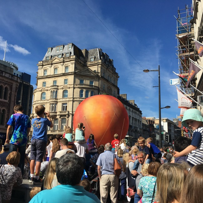 City-Of-The-Unexpected-Cardiff-Celebrates-Roald-Dahl-crowds-waiting-for-something-yep-it-is-a-giant-peach