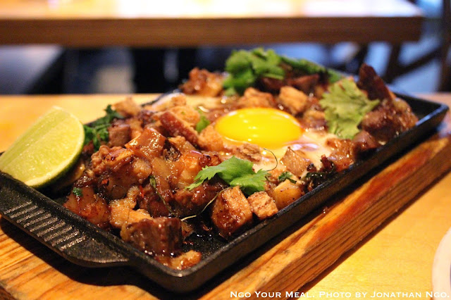 Sizzling Sisig: Pork Head, Chili, Whole Egg at Pig & Khao