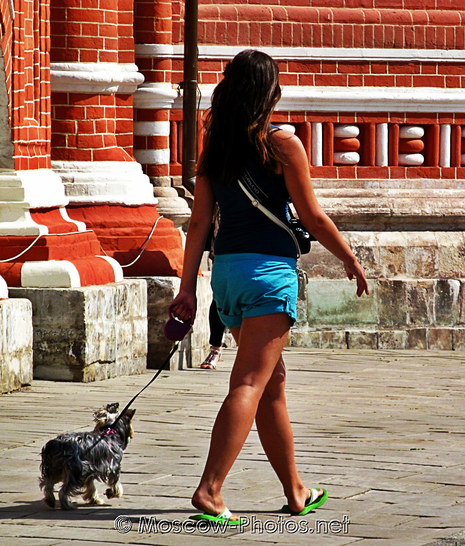 Tanned girl with doggie