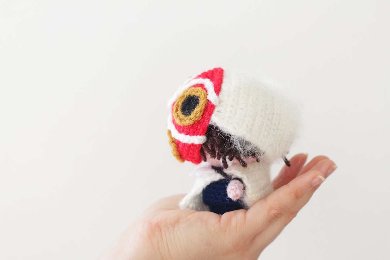 Amigurumi princess mononoke free pattern with mask shown from the side by The Sun and the Turtle