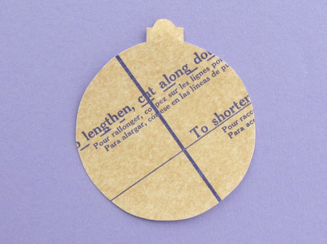 Bauble shape decorated with an old sewing pattern