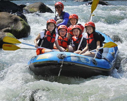 Tinuku Travel Progo River rafting trips enjoy class 5 sensation riding boat on big stone and view Menoreh mountains