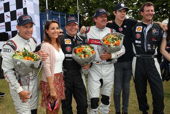 Princess Marie wore a new Sandro top and floral print ruffle summer skirt at the Historic Grand Prix. Princess Athena