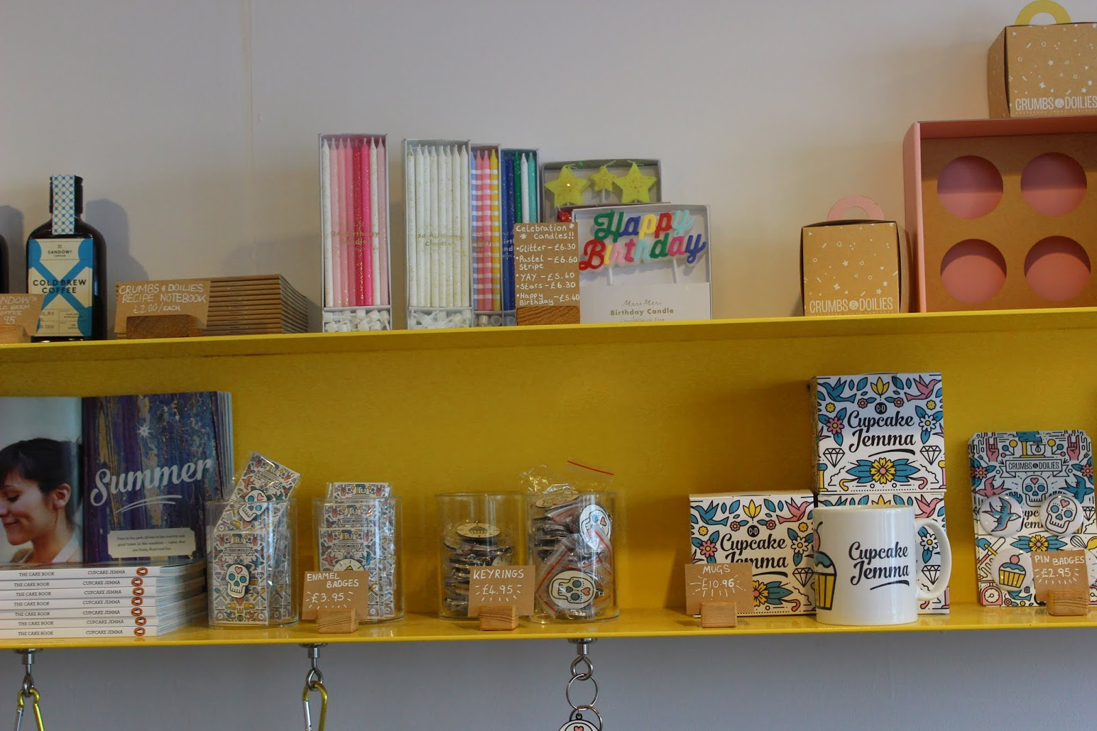 A yellow, colourful bookshelf with baking supplies