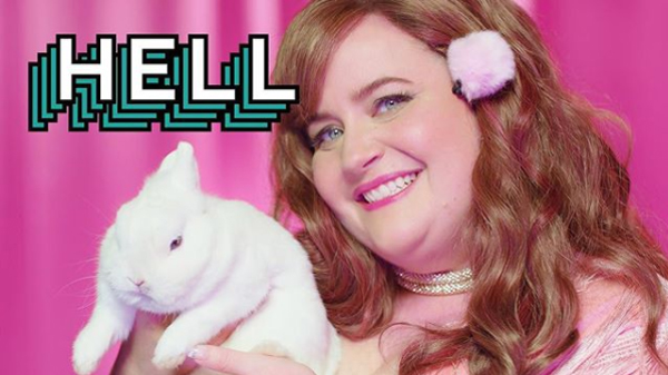 image of Aidy Bryant holding up a bunny, with the word HELL onscreen
