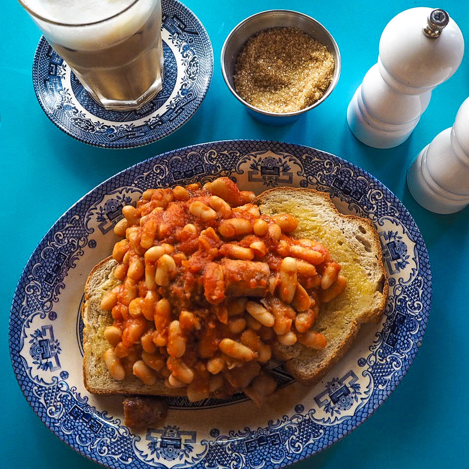 Homemade baked beans and sausages on toast