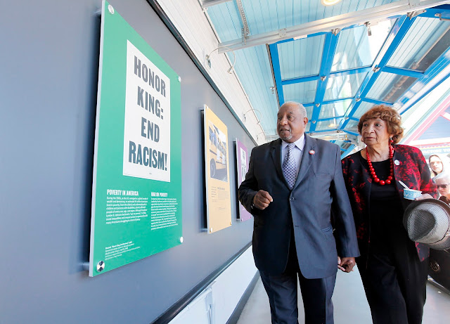 Dr. Bernard LaFayette and his wife, Kate, stroll through a new exhibit on the 1968 Poor People's Campaign installed at Ben & Jerry's factory in Waterbury, VT.