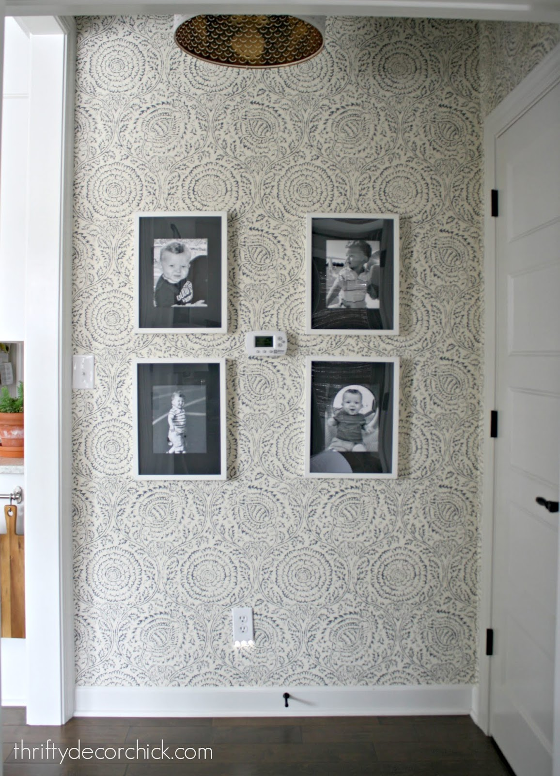 Gallery wall with wallpaper in hallway