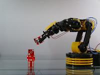 Image of robot lifting dice.