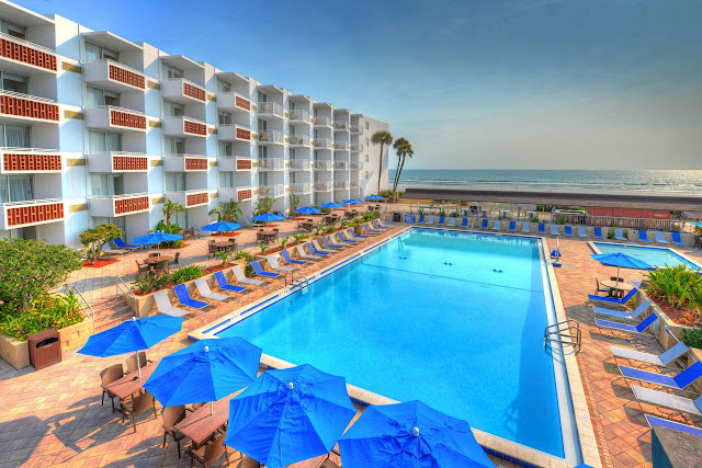 Enjoy ocean views and sunrises from your private, oceanfront Best Western Aku Tiki Inn Daytona Beach hotel balcony and play in the tropical Atlantic ocean.