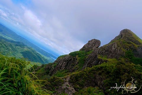 The parrot's beak of Mt. Pico de Loro against the blue cloudy sky hover_share