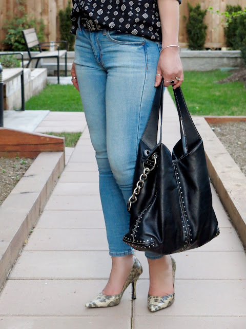 faded skinny jeans, animal-print pumps, black studded Michael Kors bag