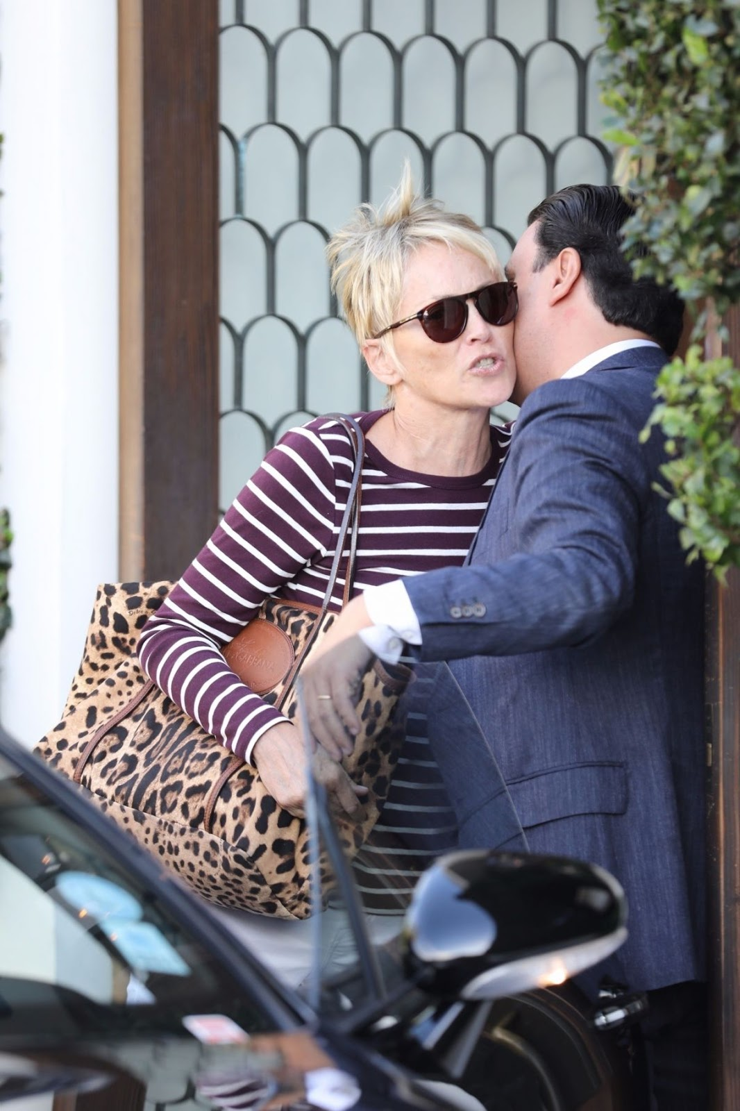 Photos of Sharon Stone riding in her car at Cecconi's in West Hollywood