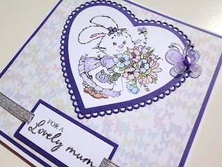 Stamped and colored Mothers Day card with bunny rabbit and flowers