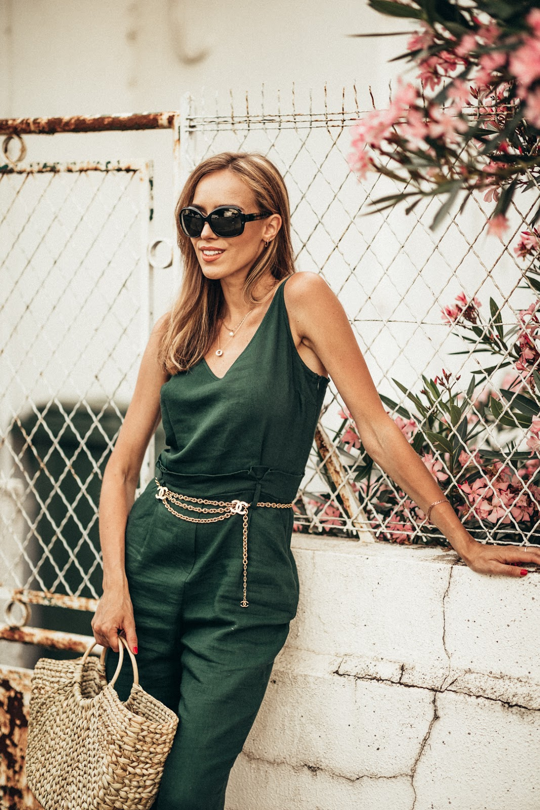 green jumpsuit chanel belt outfit