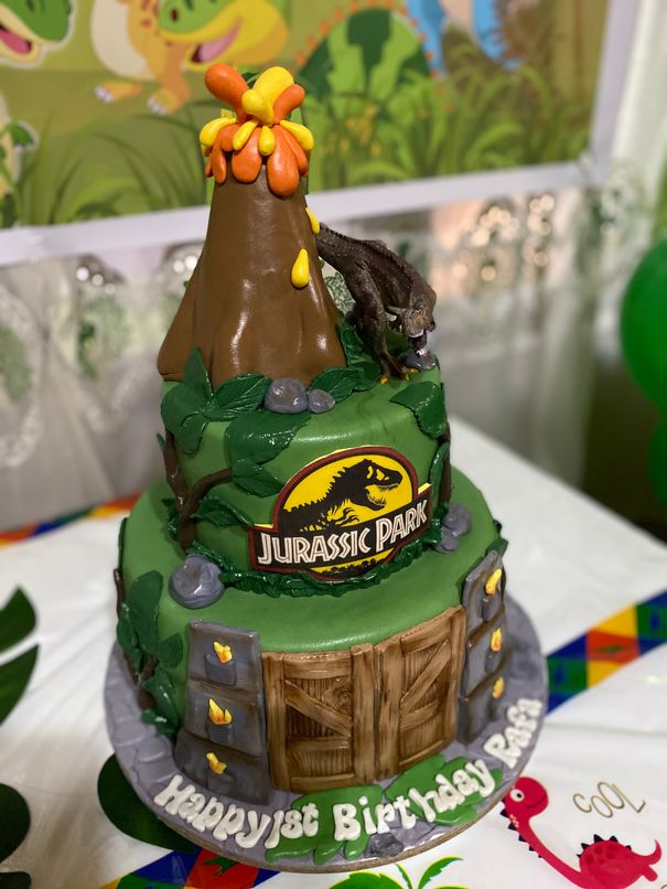Dinosaur-themed cake by Cakes, Cookies, & Co.