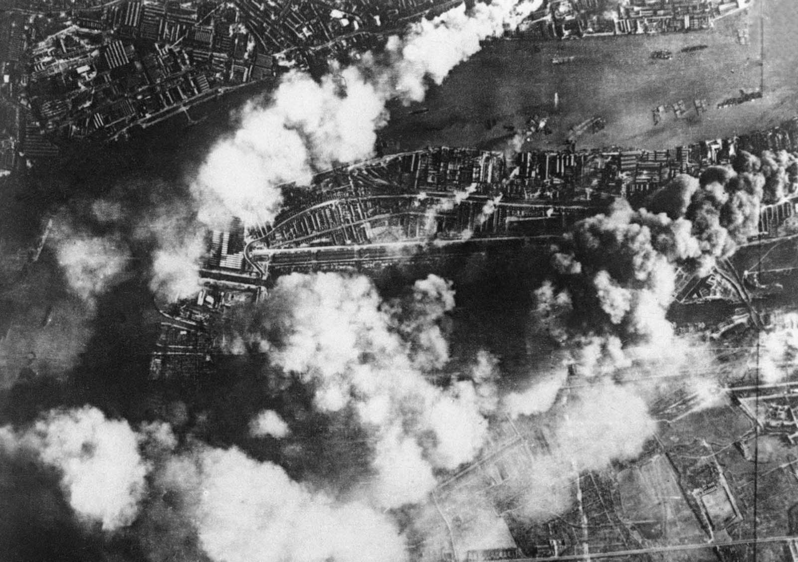 The effects of a large concentrated attack by the German Luftwaffe, on London dock and industry districts, on September 7, 1940. Factories and storehouses were seriously damaged; the mills at the Victories Docks (below at left) show damage wrought by fire.