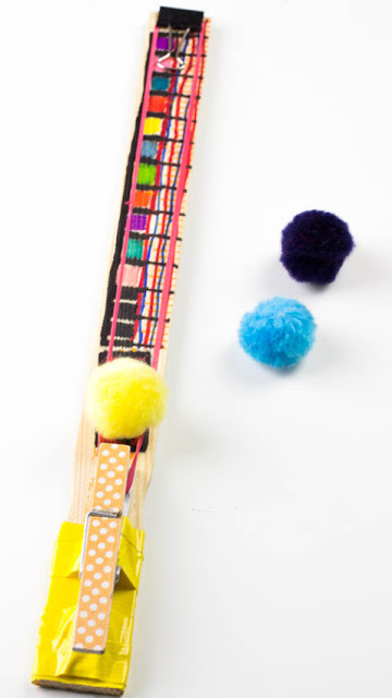 Easy Rubber Band Pom Pom Shooter Toy - Super Fun STEAM project to craft with kids.  You probably already own all the materials!