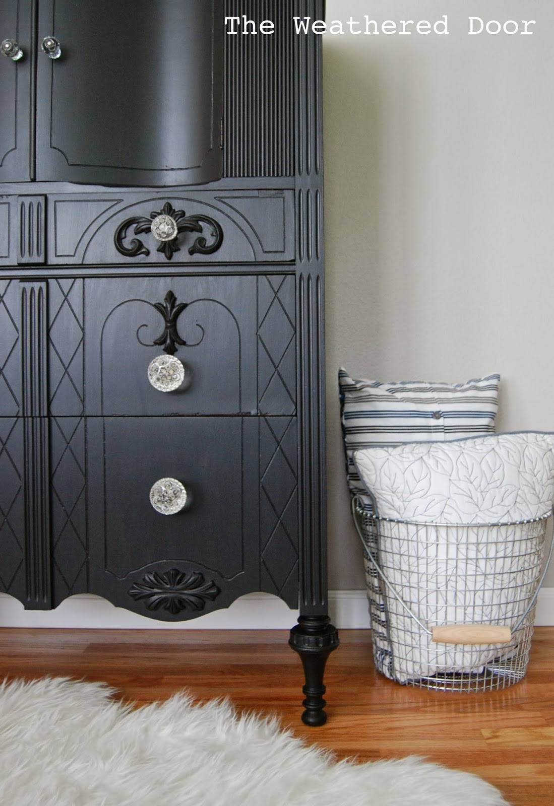 a tall black dresser with glass knobs the weathered door. Black Bedroom Furniture Sets. Home Design Ideas