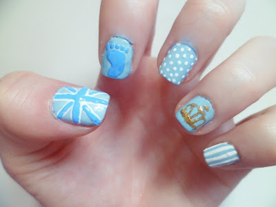 A close up image of nail art inspired by the birth of the royal baby