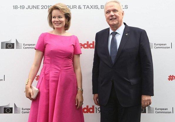 Queen Mathilde wore a new pink midi dress by Natan