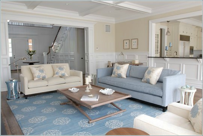 Coastal cottage living room with light blue and white upholstered sofas