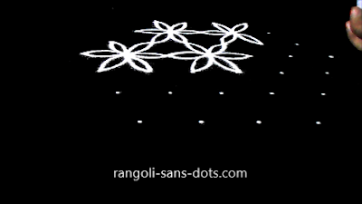 Poo-kolam-with-7-dots-910af.jpg