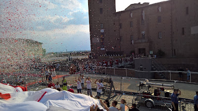 The Borgo San Bernardo entourage exits the castle and presents itself to the palio.