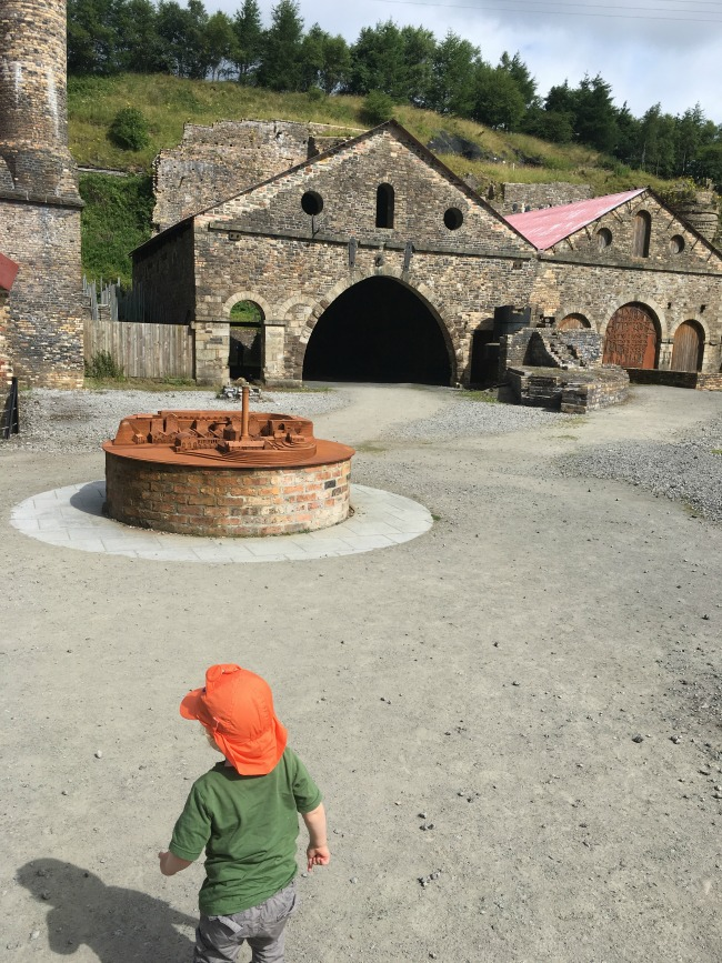 Blaenavon-Ironworks-A-Toddler-walking-towards-iron-model