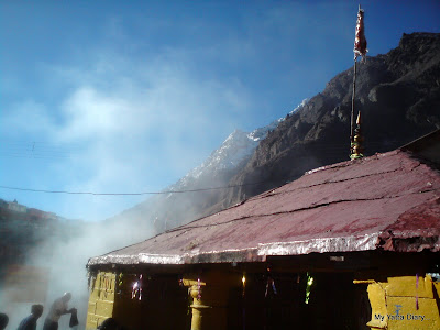 Fumes emanating from theTapt Kund with snow peaks in the  background, Badrinath
