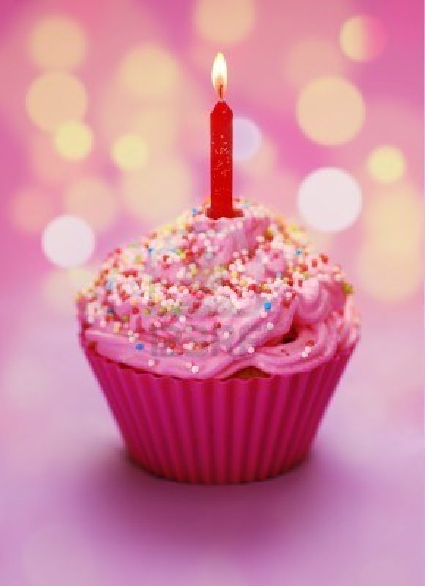 7977550 pink birthday cupcake with a candle