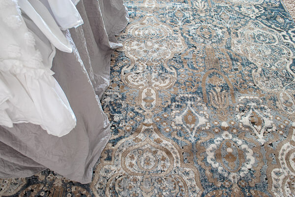 deep blue and neutral damask area rug