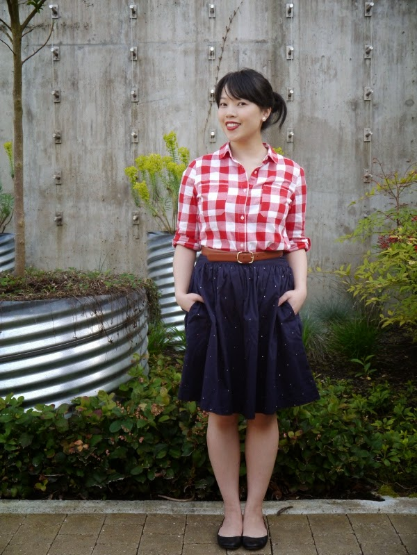 Red and white check shirt with A-line navy skirt and black ballet flats