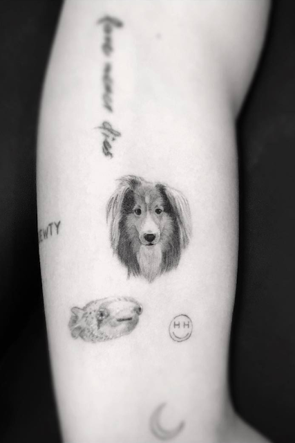 Miley Cyrus Dog Tattoo on her left arm
