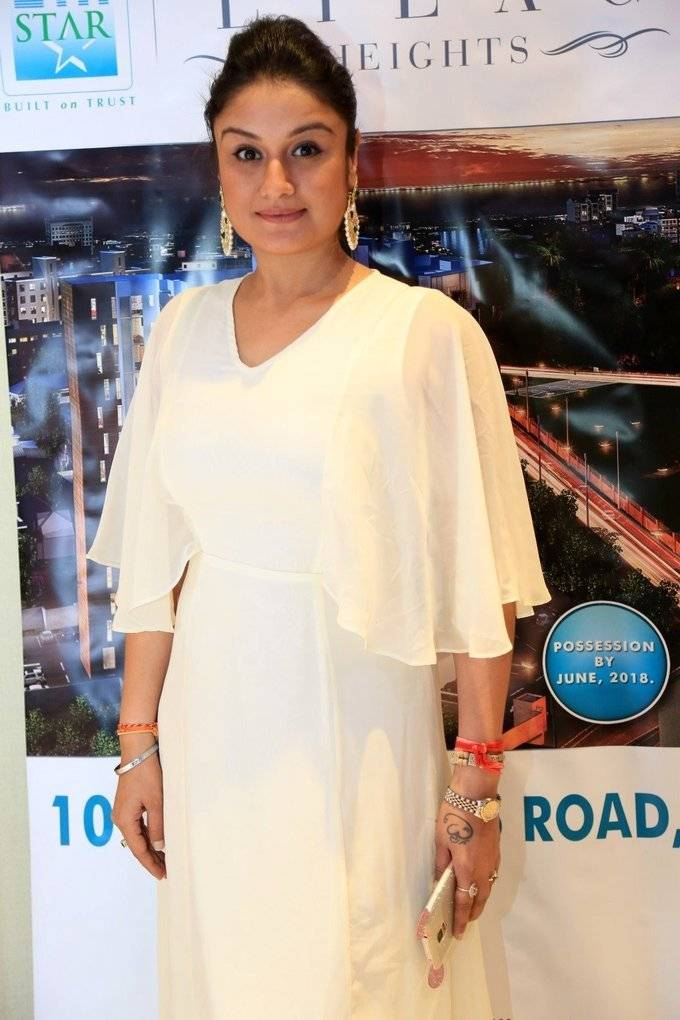 Punjabi Girl Sonia Agarwal Stills In Long White Color Gown