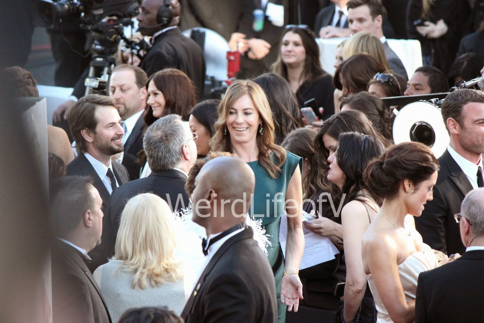 Director Kathryn Bigelow (in green dress)