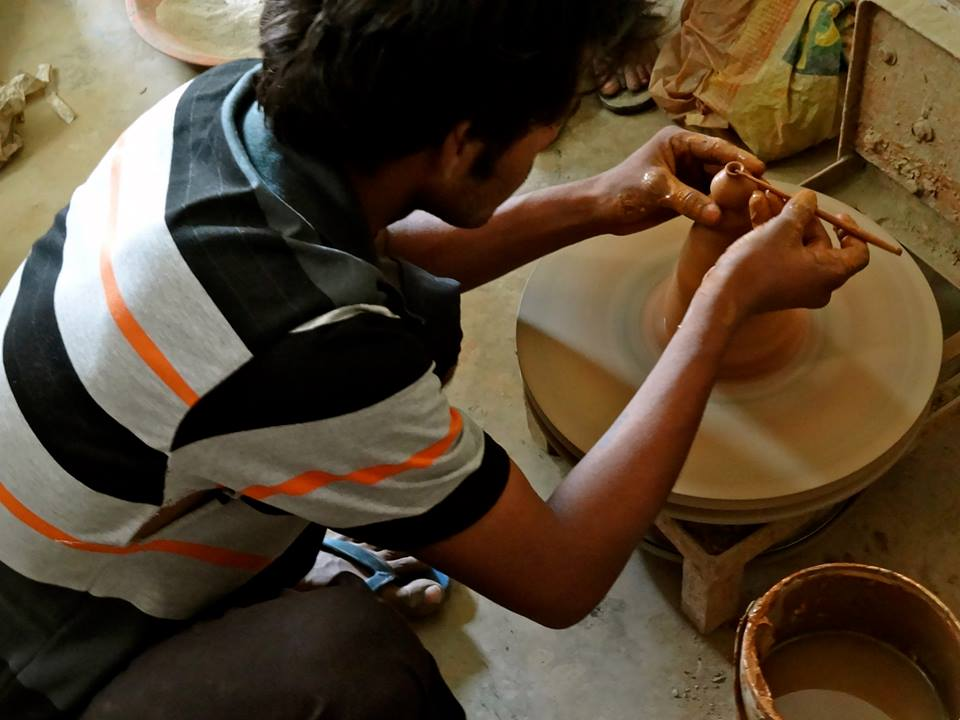 A potter at work in the pottery village in Delhi