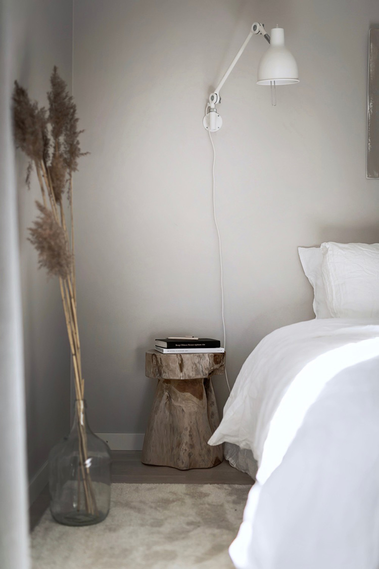 Bedroom with trunk stool as nightstand. Residence Magazine (Lovisa Häger and Loft Stockholm)