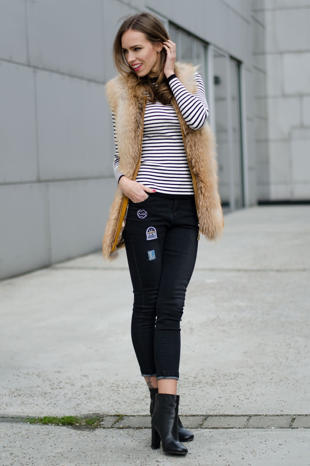 kristjaana mere striped sweater fur vest skinny jeans ankle boots winter look