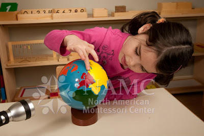 young girl works with NAMC montessori globe ideas for equinox activities