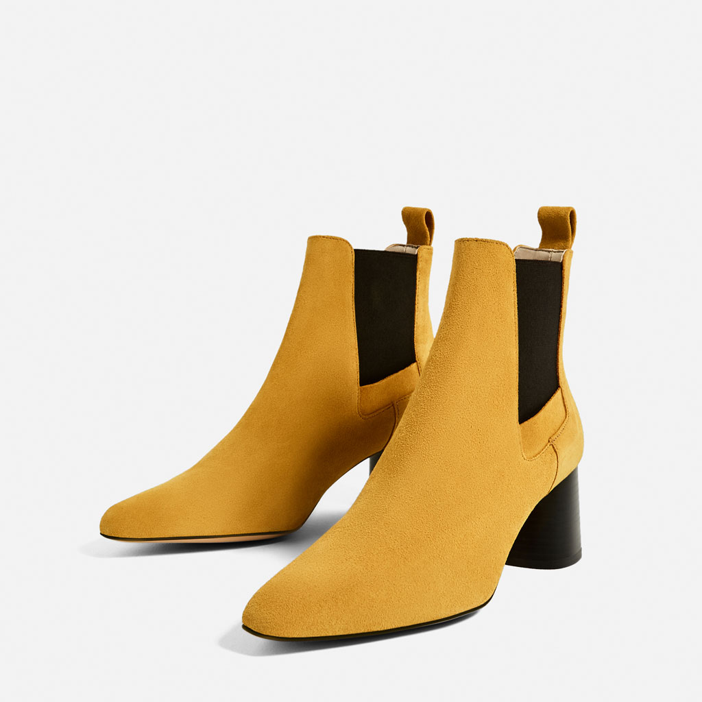e8202acf81b Mustard high heel leather ankle boots. Side stretch panels. Rear pull-tab.  Rounded toe. Block heel.