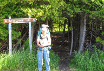 hiker with backpack by a trailhead