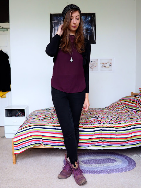 Dr Facilier Disneybound outfit of purple top, black jeans & jacket, black beanie and purple combat boots