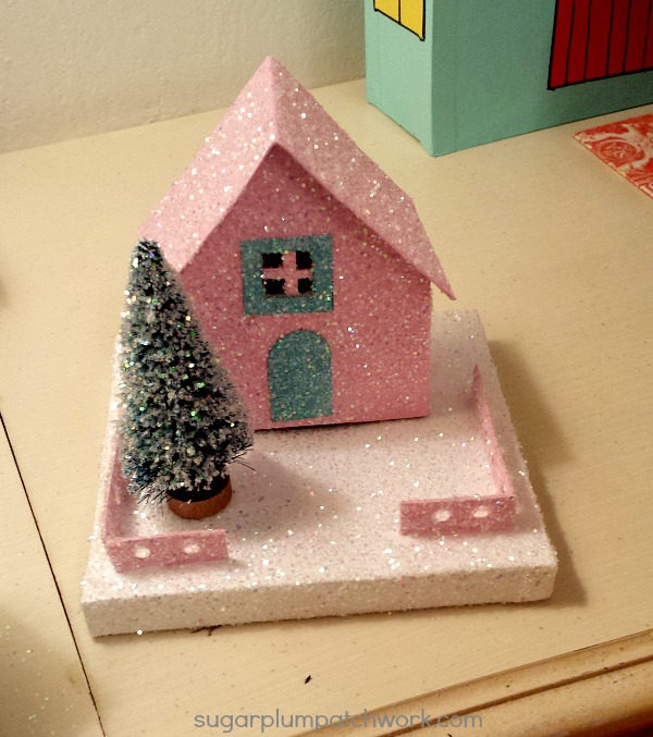 little pink glitter house with tree