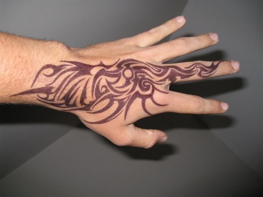 cool hand tribal tattoos